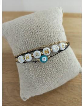 Bracelet doré et noir Chance